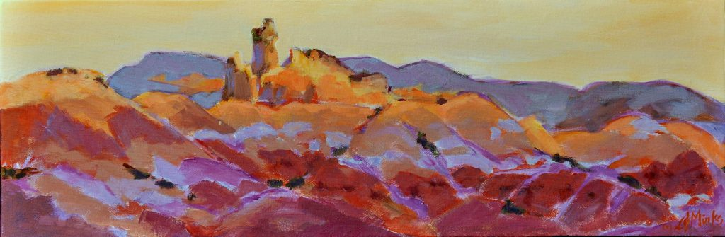 A painting of rocky southwestern mountains at sunset