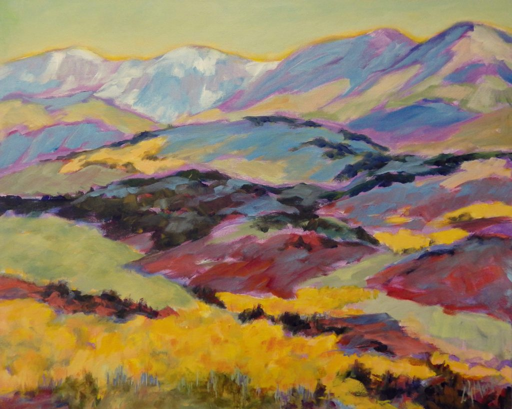 A painting of rolling hills and mountains in the autumn