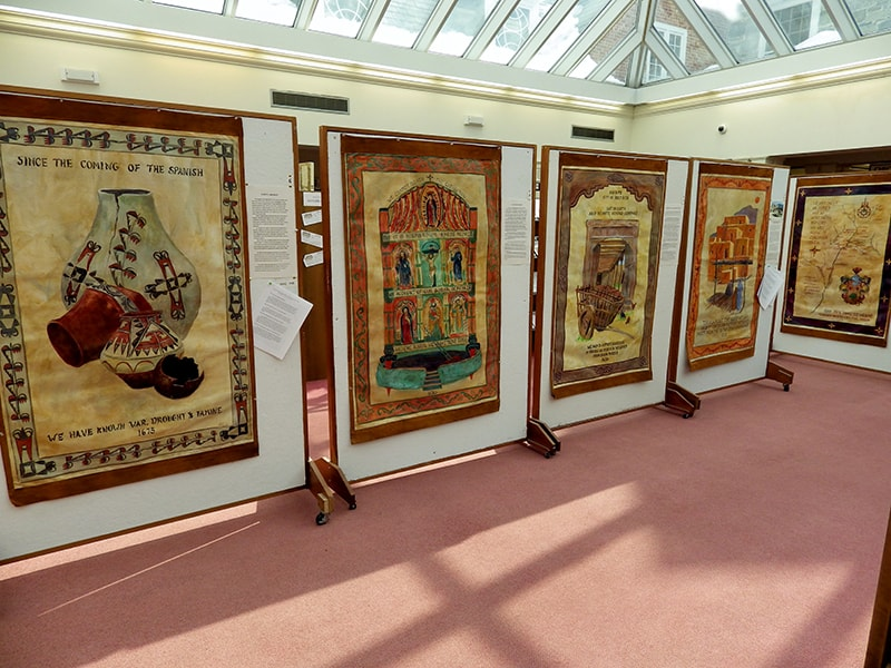 A gallery display of large pieces of artwork