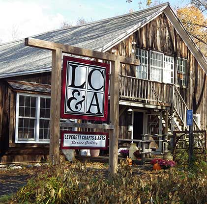 The front of the Leverett Crafts and Arts Center, alarge old barn-style building in Leverett, Massachusetts