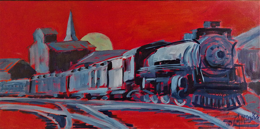 A train approaches a small downtown with a bright red background
