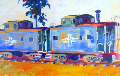 Two old looking blue train cabooses resting on their tracks